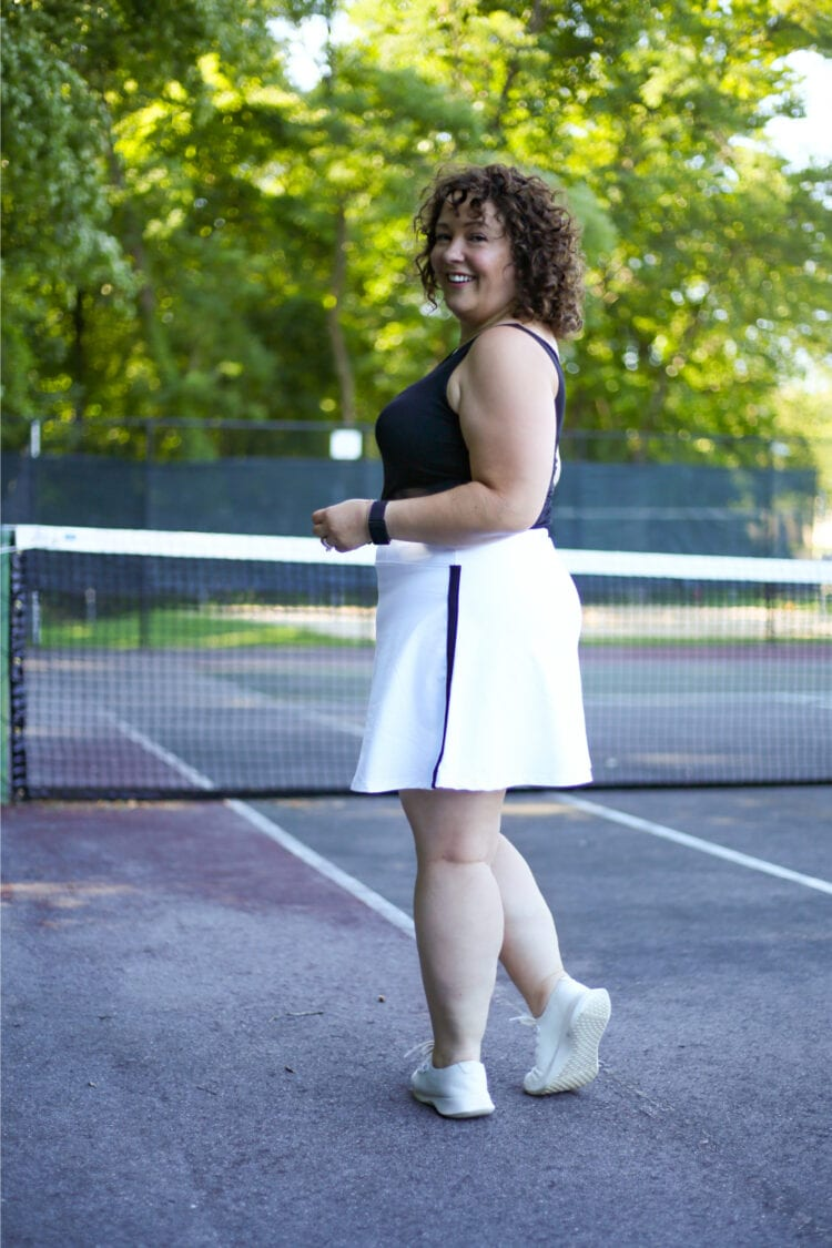 Alison in a black tank and white Talbots skort