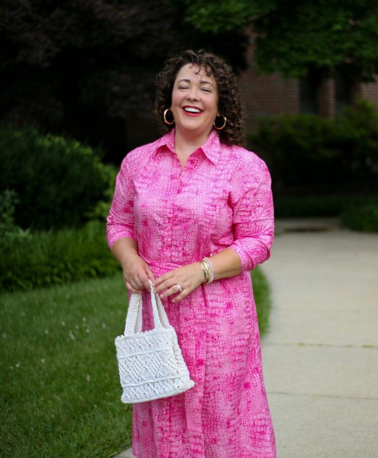 Alison of Wardrobe Oxygen holding a white fintage crocheted frame handbag