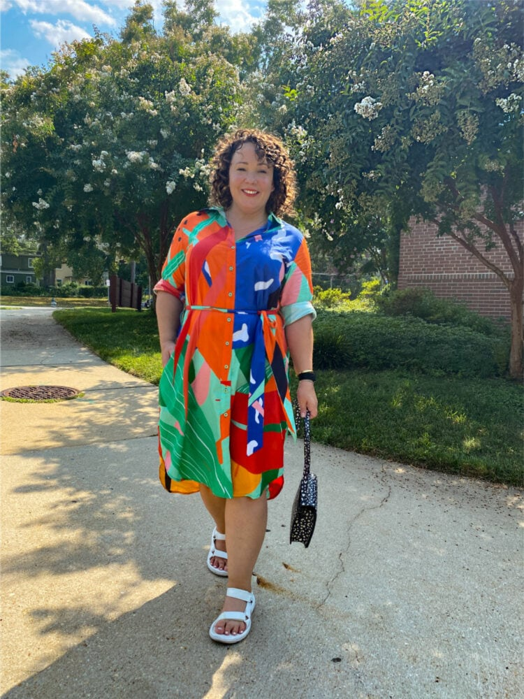 wardrobe oxygen in a dressed in joy shirtdress from the brand's resortwear collection