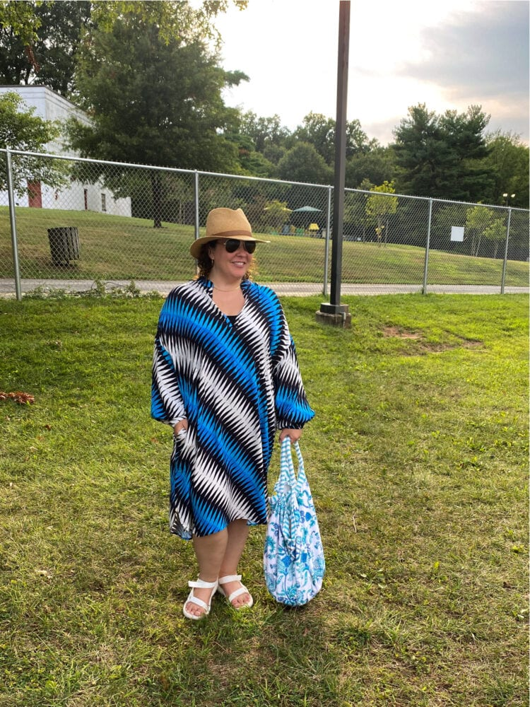 Alison in a blue and black and white graphic print sleeved caftan dress from Essentiel Antwerp
