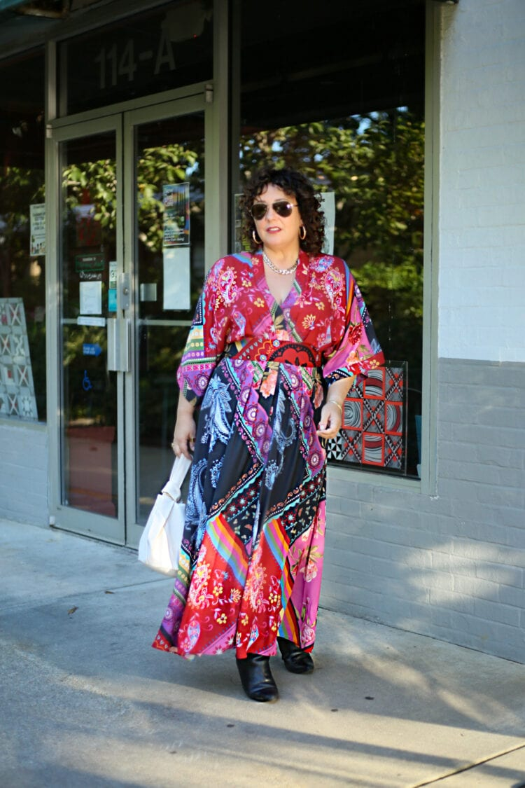 Wardrobe Oxygen in a red printed maxi dress from eShakti that has bell sleeves and a v-neckline