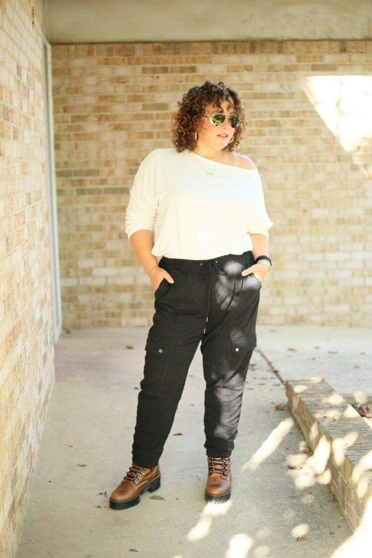Alison of Wardrobe Oxygen in a white ALLSAINTS off the shoulder long sleeved tee with black cargo pants from Banana Republic