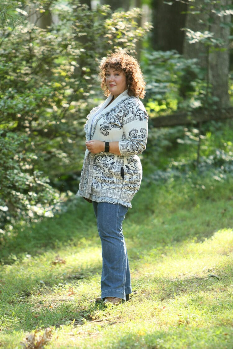 Wardrobe Oxygen in a Chico's belted cardigan sweater with a blue print on ivory